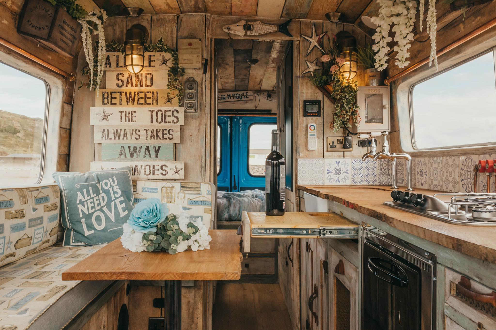 interior view of ernie by supertramped campervan kitchen with wine rack