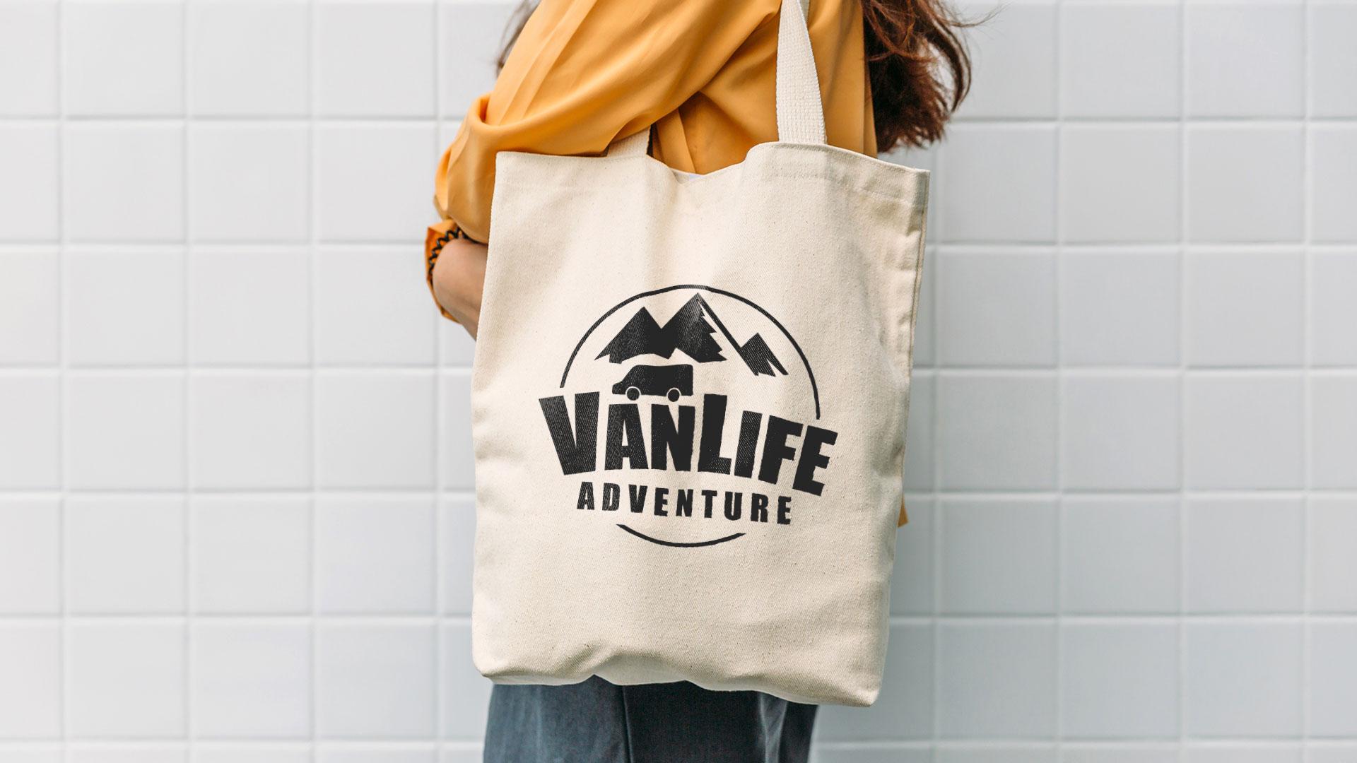 woman holding a VanLife tote bag eco-friendly campervan